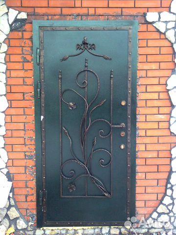 производство входных кованных дверей