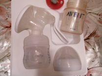 Молокоотсос и стерилизатор